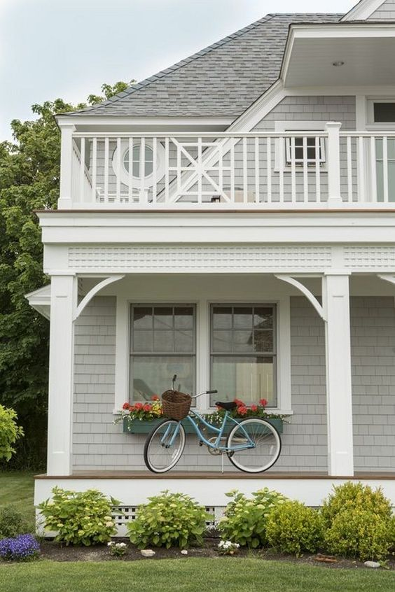 Beach house porch with turquoise bike. A. Tesa Architecture
