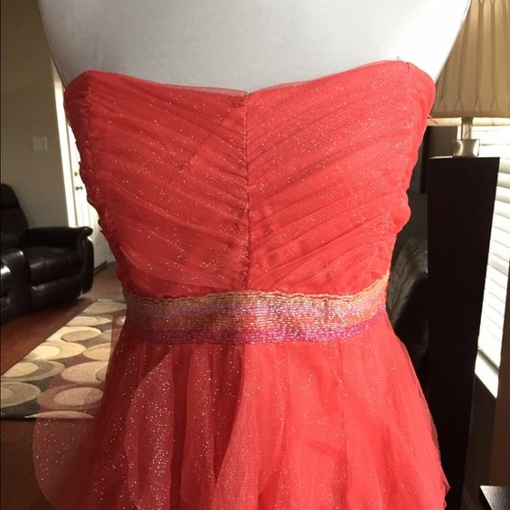 Elegent Ruffle Cascading Dress Coral color dress with glitter all over fabric, strapless, beading around waist high-low style size 9 by Teeze Me NWT Teeze Me Dresses High Low