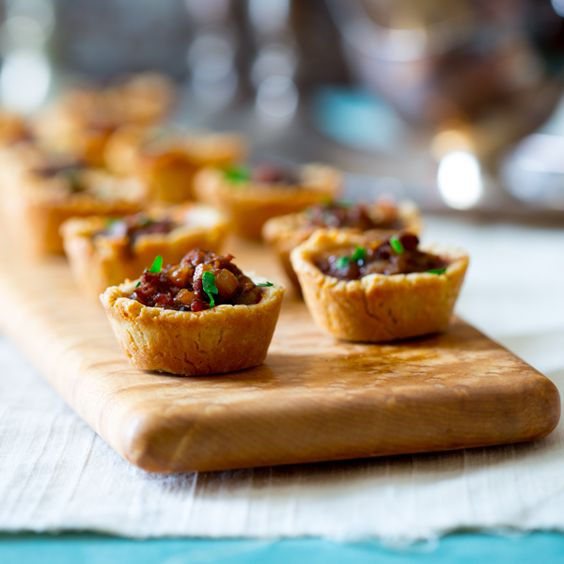 mini beef wellington pot pies  Two tone tablecloth Depth of field Rustic board matches pastry colour!