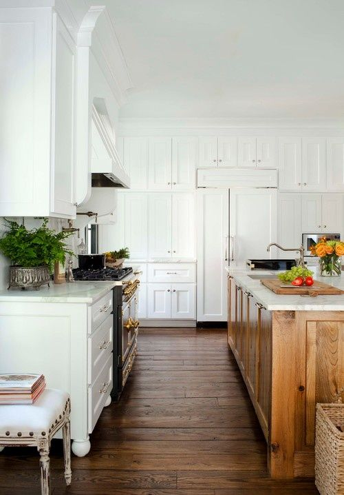 white cabinets, wood island