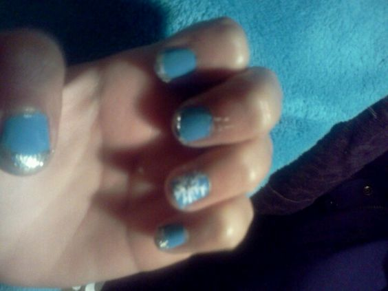 Light blue silver tip snowflake on ring finger winter nails
