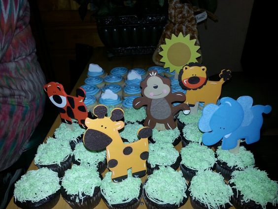 Baby shower cupcakes.  Animal theme. Clouds are cut marshmallow