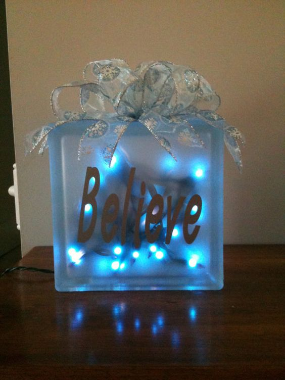 8x8 glass block with silver and blue snowflake ribbon.