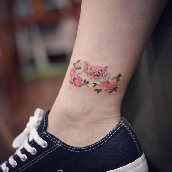 Small pig tattoo on the right inner ankle. Tattoo artist: Woori
