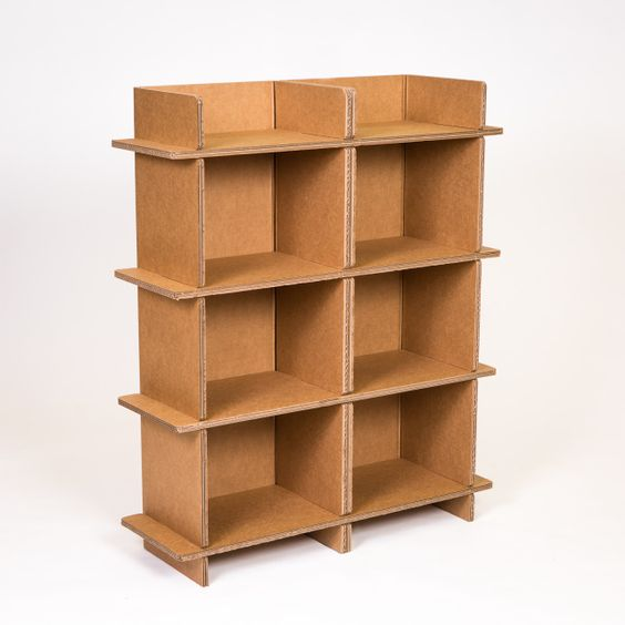 The Double Shelf Is Twice As Useful It Also Serves As A Great Space Divider For Multipurpose Rooms Cardboard Furniture Cardboard Crafts Diy Cardboard Storage
