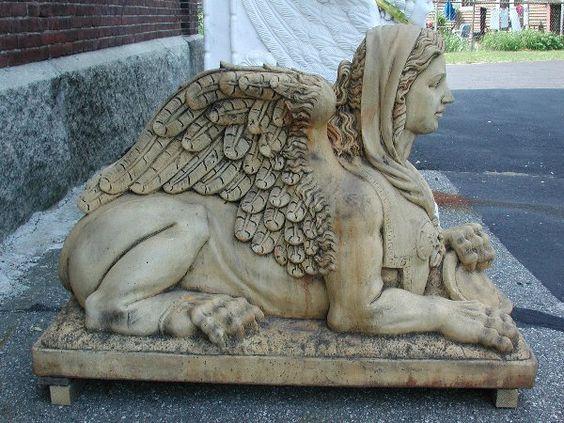 Elaborate pair of stone winged lady sphinx