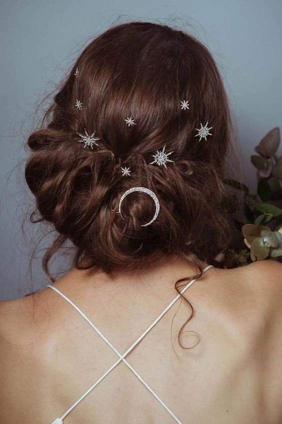 From twinkling hairpins to full-on tiaras, bridal hair accessories have upped their game in recent years. #weddinghair #weddinghairaccessories #weddinghairpins #starhairpins #braidedweddinghair