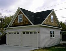 Custom 22x24 reverse gable garage with third gable for Reverse gable garage