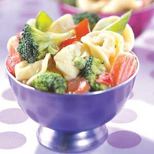 Terrific Tortellini Salad Bright colored vegetables added to cheese-filled tortellini make a satisfying yet low calorie meal that's perfect for lunch.