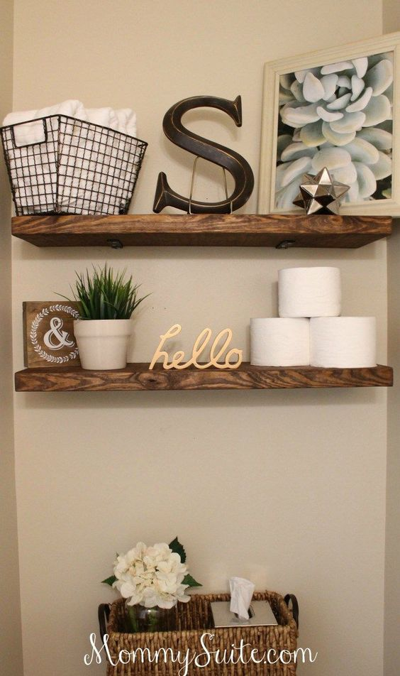 Simple floating shelves in the bathroom take advantage of vertical wall space and give you extra storage space!