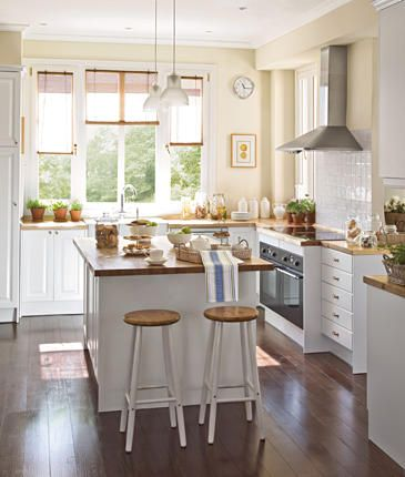 white and wood - discret lights - opened feeling with no top cabinet