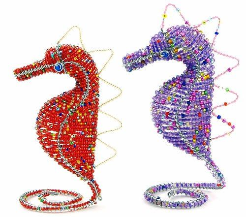 These beaded animal figurines are handcrafted by talented disadvantaged bead-and-wire artists in the townships near Cape Town, South Africa...
