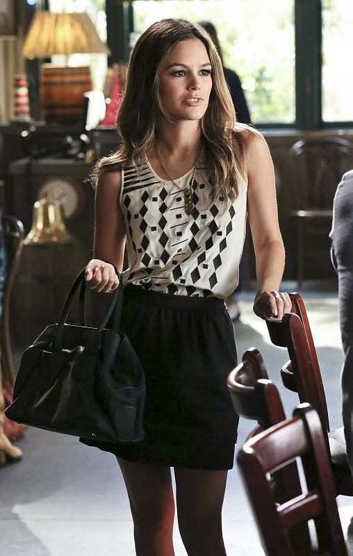 Steal Zoe's business-casual ensemble by tucking her printed Madewell tank ($56, originally $72) into this J.Crew mini ($98).