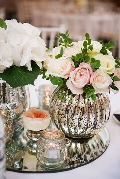 Centerpiece of mercury glass and pink roses... #mercuryglass #wedding