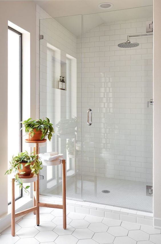 We love the lightness and brightness in this bathroom, as well as the all white tiles in the different designs.