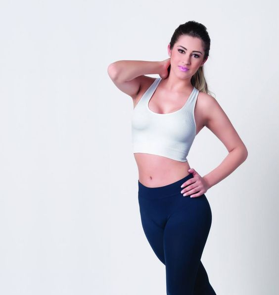 Pretty and athletic girl tank top and yoga trousers