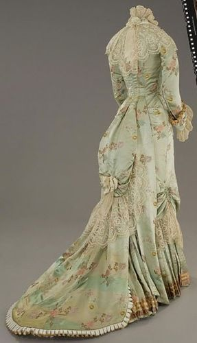 "dress used in The Age of Innocence which is set in the 1870s. This could also be considered a ""princess line"" dress."