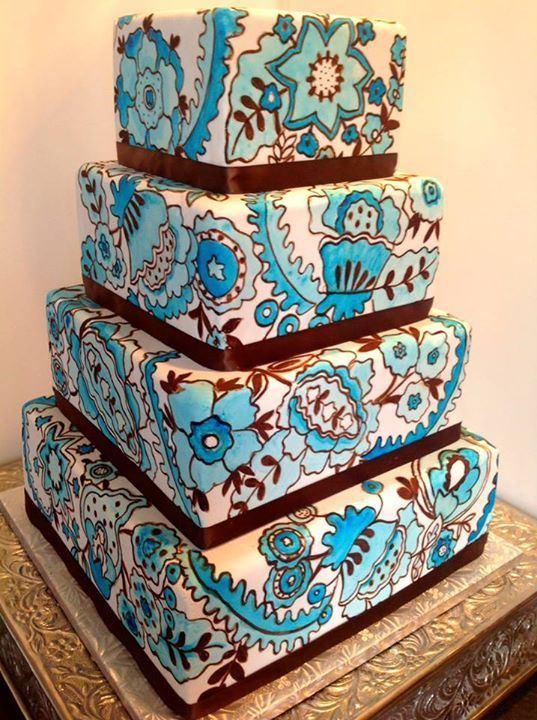 Pretty Shades of Blue Hand Painted Tiered Cake. Paisley cake in blue and white on four tiers of grand artistry.