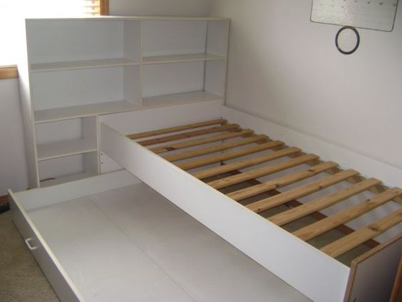 Trundle Bed with book shelves. REALLY like this one because of the bookshelf --- would help Margie with storage issue she thinks she will have