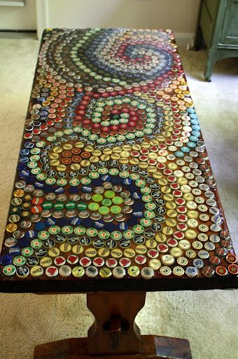 Bottle cap mosaic table top~For a man cave, or a redo top to your old outdoor party table.  Once glued in place (Tite-Bond clear would work well for this), then pour a resin cover over entire top to seal the project.