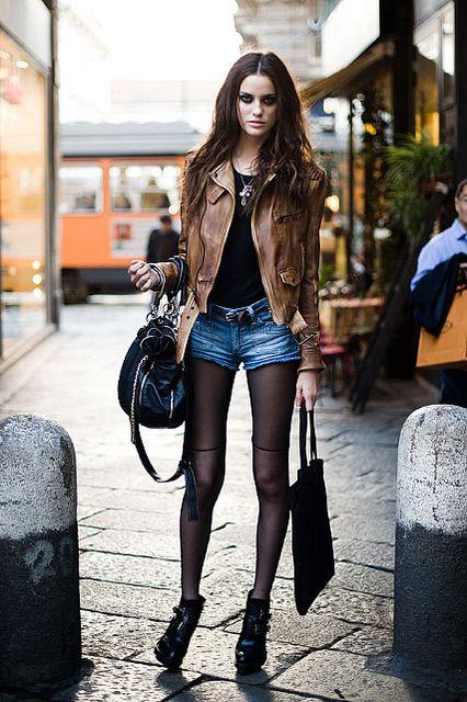 Leather jacket.. brown sheer tights short shorts and black