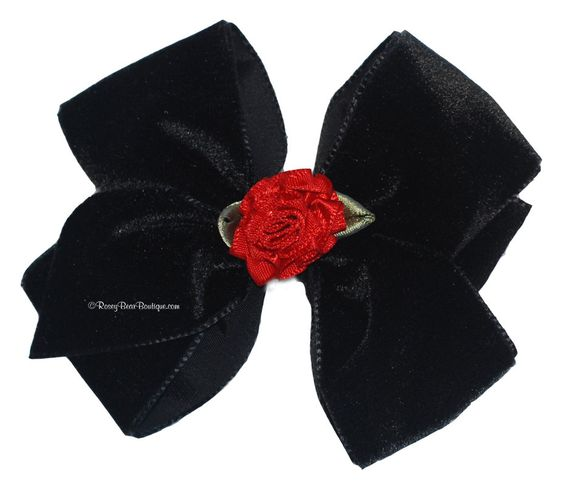 "Black Velvet Hair Bow with Red Satin Rosette - 3.5"". $6.00, via Etsy."