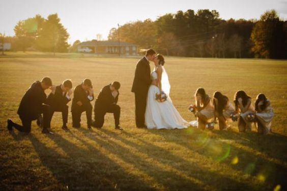 """""""Nuptial Tebowing.""""  Love this shot for the wedding party.  Click to see more Tebowing!!"""