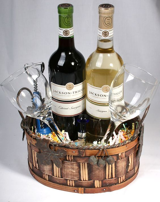 Great for Gift Basket Idea!  This wine lovers basket is super simple, two bottles of wine, two wine glasses, a cork screw, all tucked into a nice basket then wrap it up!