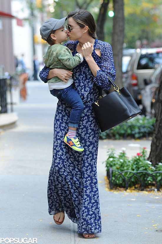 October 20, 2013: Miranda Kerr Smothers Her Smiley Guy, Flynn Bloom, With Kisses