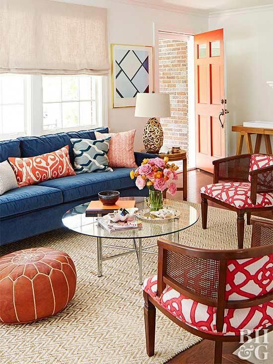 A Navy Blue Sofa Establishes This Room S Complementary Color Scheme Bright Red Appears In 2020 Blue Sofas Living Room Blue Couch Living Room Living Room Color Schemes #red #and #tan #living #room