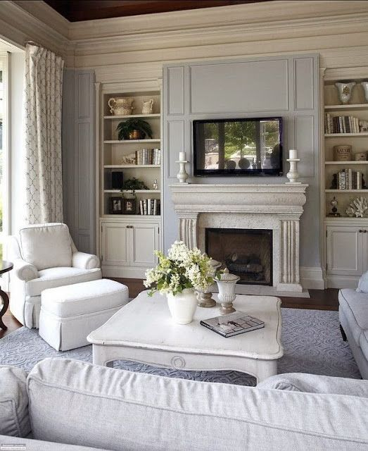 Traditional living room with soft blue and white. Beautiful Classically Refined Rooms.