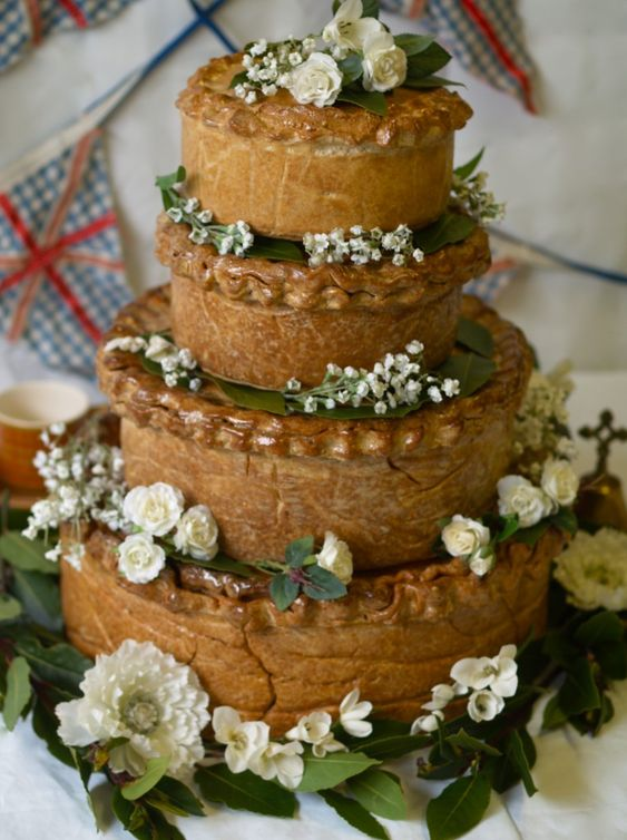 Our vintage style bespoke wedding pork pie instead of a traditional cake. Buffet and cake in one!   Individual layers of the big pork pies work spectacularly for parties too (and we can do pastry lettering, hearts, flowers etc).