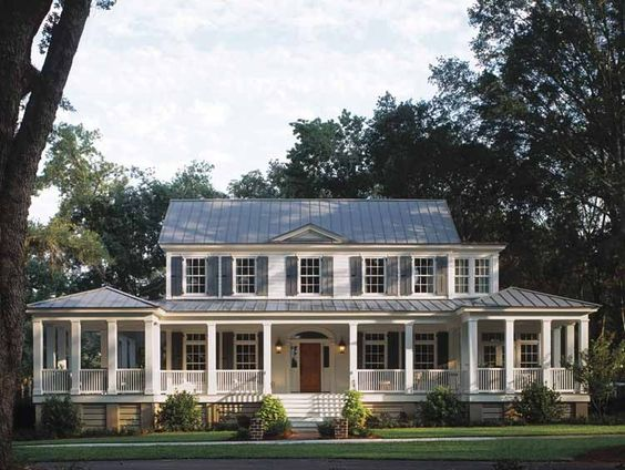 I've always wanted a white home with a wrap around porch, black shutters, perfect dream home. :)