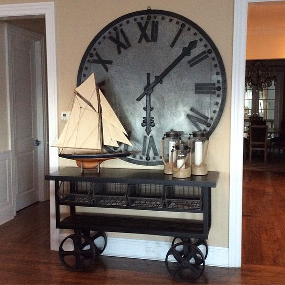 Over-sized galvanized clock. Paired with this industrial metal console table.
