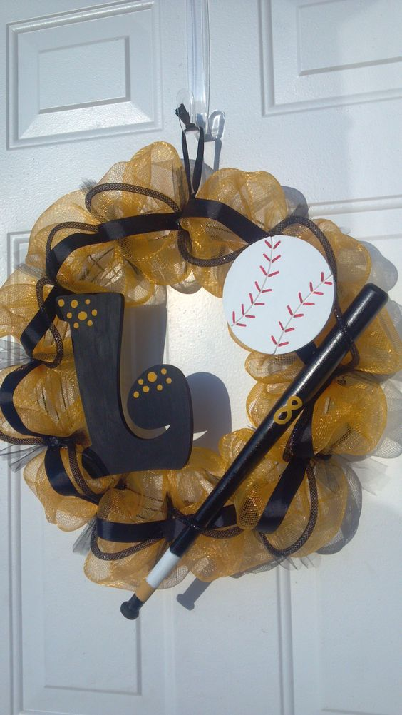 Sports Deco Mesh wreath by Tonia. Made this one for my friend whose son plays baseball. School colors are gold and black.