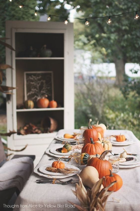 Beautiful Fall table spread. Lovely for a fall dinner party, Thanksgiving dinner, and more. We love the pumpkin place-settings.