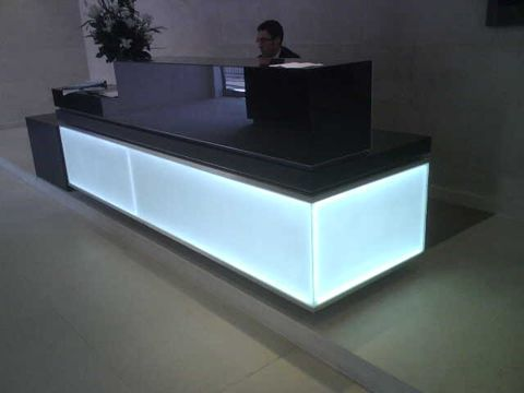 laser etched acrylic panels with leds embedded to create a light guide plate for lighting this reception counter reception desks reception design acrylic lighted reception desk reception counter design