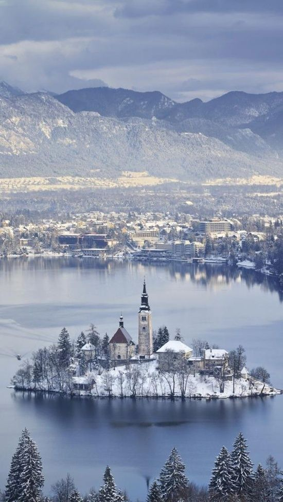Bled Island surrounded by Lake Bled, Slovenia …                              …