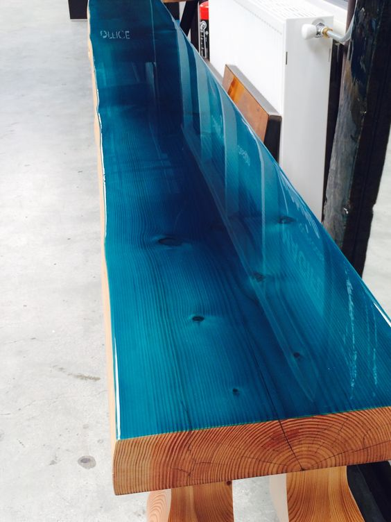 Close up Douglas tree trunk with ocean blue color coating Www.ccoating.nl