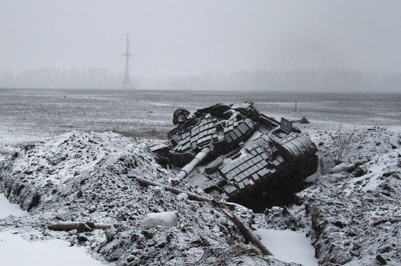 A destroyed Ukrainian army tank is photographed outside Uglegorsk. The leaders of Russia, Ukraine, France and Germany reached a ceasefire deal last week after 17 hours of talks in Minsk, Belarus.