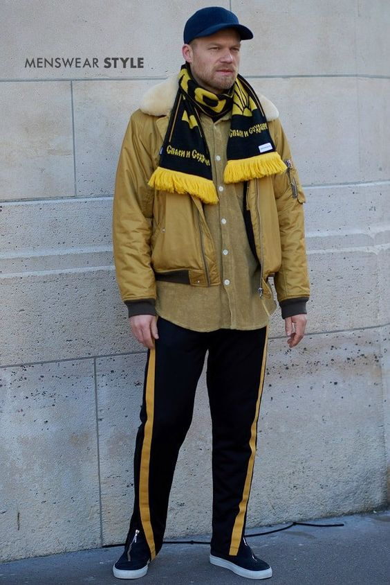 A trending look of sportswear, terrace fashion and streetwear combined, seen on the streets of Paris in 2018.