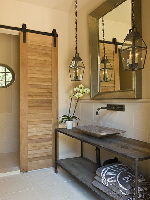 Louvered barn doors hanging lanterns wall faucet and for Luxe decor llp