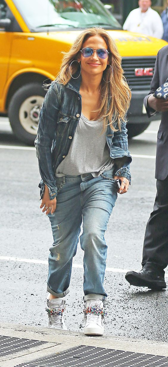Jennifer Lopez's gorgeous bronze skin popped underneath sleek aviators with psychedelic purple 'n' blue tinted lenses!