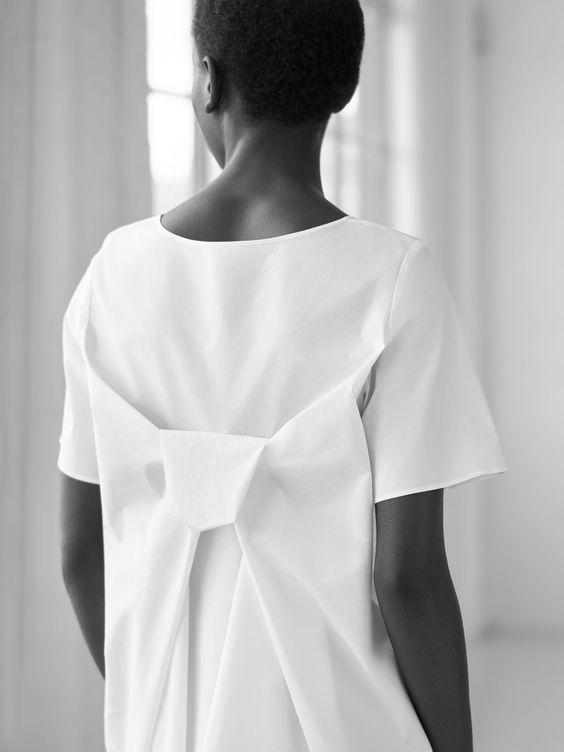 Simplicity - understated dress with draped bow back detail; minimalist style; minimal fashion // COS