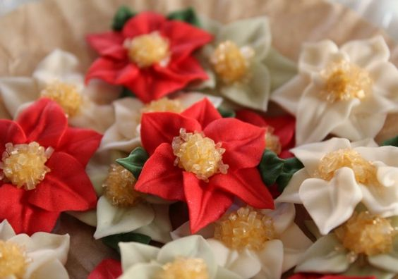 Royal icing poinsettias, courtesy of The Sweet Adventures of Sugarbelle.