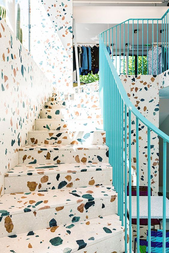 PIN 9 - This is a unique looking tirrazzo. It is a larger design compared to the usually small speckles of stone. What a playful and bright look it gives to the stairs, specially accompanied by the turquoise hand rails.: