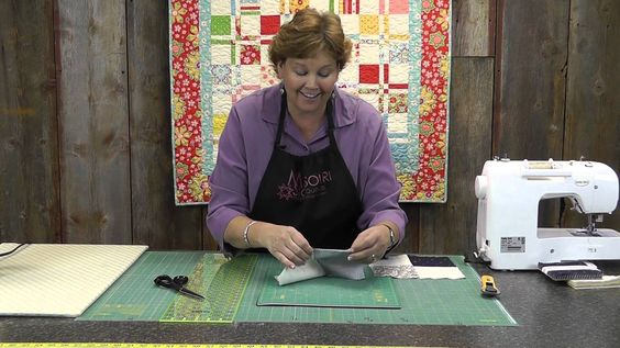 Disappearing 4 Patch Quilt Block Tutorial, via YouTube.  Missouri Quilt Co.