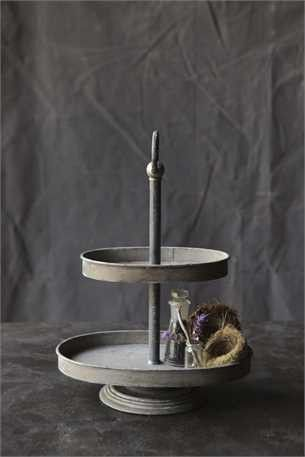"""We love this perfectly rustic, metal, two tiered tray! Perfect for display, entertaining, or for gift giving! Measures: 12-1/2""""L x 8-1/4""""W x 16-3/4""""H Zinc"""