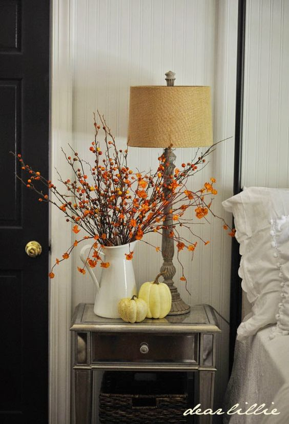 Simple fall display with pitcher of bittersweet and pumpkins (From Dear Lillie)   Friday Favorites on www.andersonandgrant.com