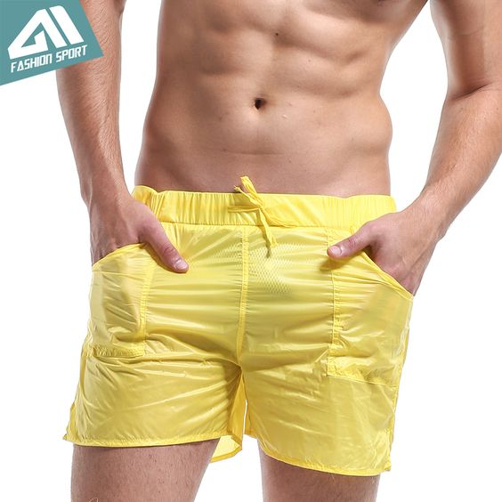 DESMIIT Men's Pocket Beach Shorts Solid Super Light Weight Thin Sexy Quick Dry Shorts Breathable Leisure Surf Board Shorts